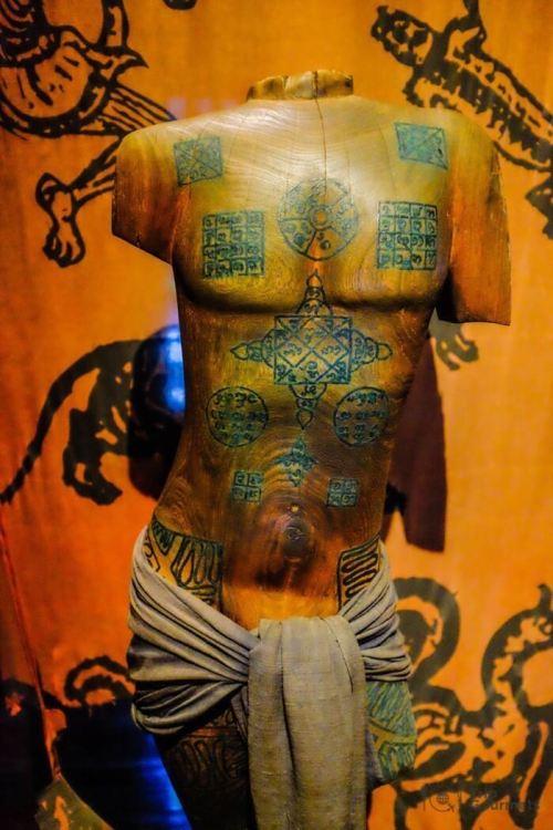 Kamthieng House Sukhumvit Bangkok traditional Lanna building chest tattoos