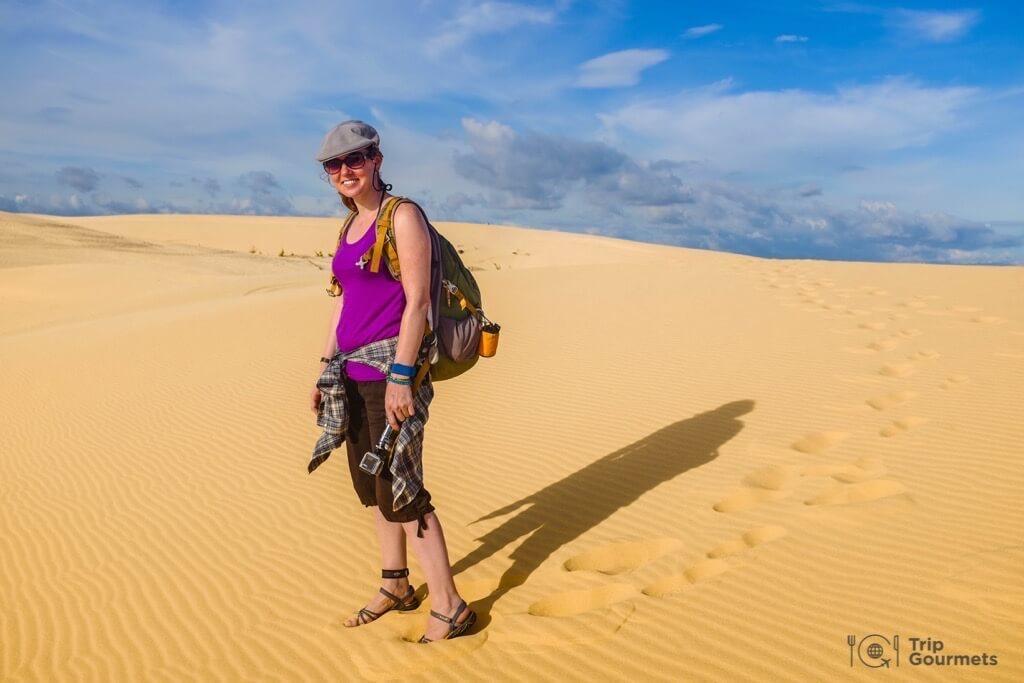 Things to do in Mui Ne Muine desert sand woman white dunes