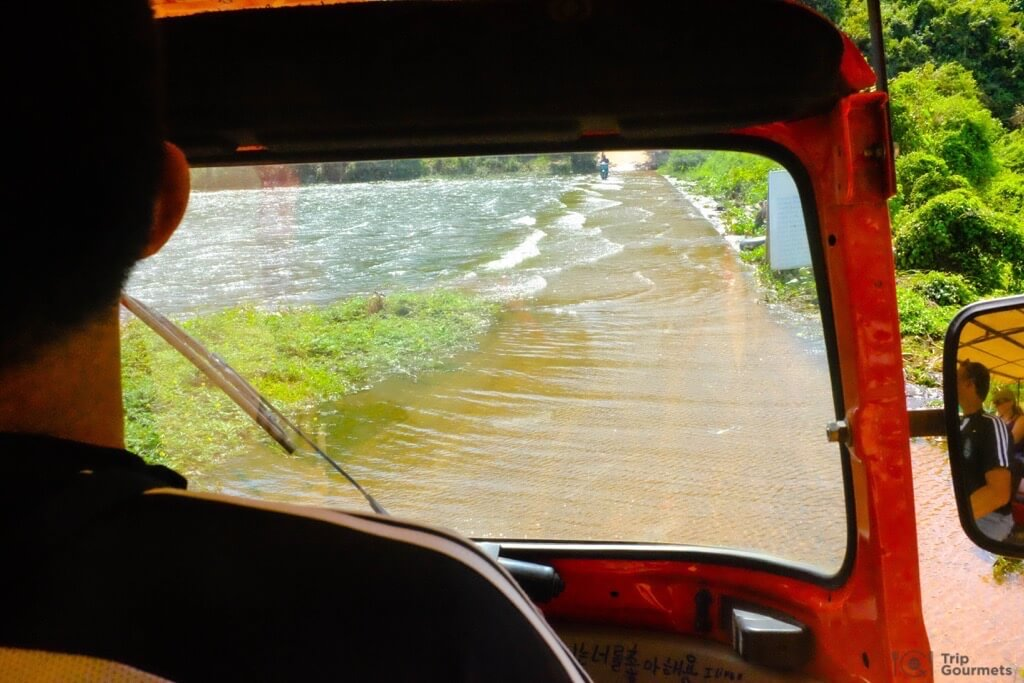 Things to do in Kampot cambodia tuktuk Secret Lake flooded street