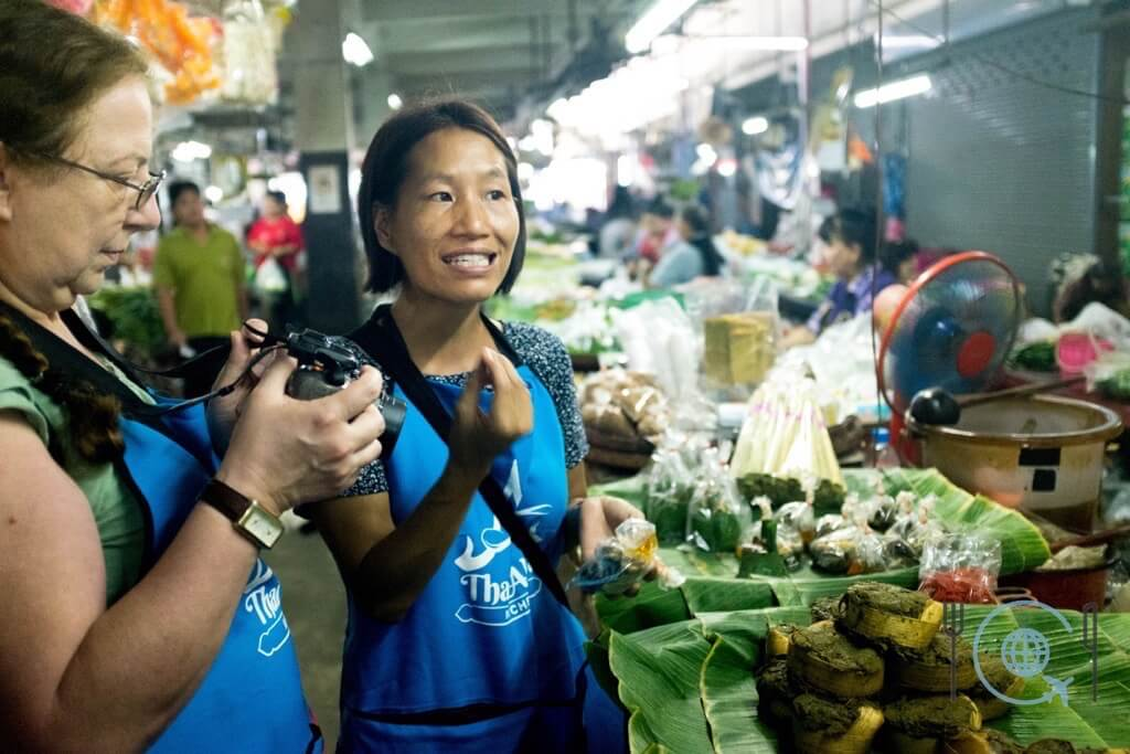 Market tour in Chiang Mai guide explaining