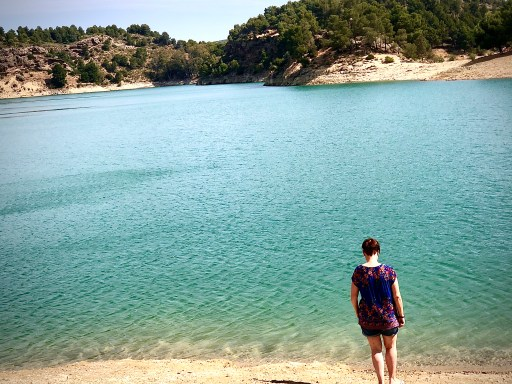Woman standing by a lake in spain in camp ardales