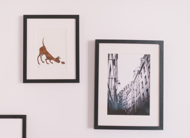 photos on a wall - add art to walls and make your new house feel like home