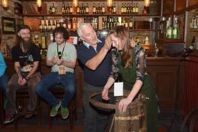 No Reproduction Fee Jameson Cooper Ger Buckley pictured at the launch of the Franciscan Well Jameson-Aged Pale Ale in the Oliver Plunkett, Cork, Ger demonstrated how to build a whiskey cask, with the help of volunteer Fiona Creedon who gets her face blackened in a time old tradition. Pic John Sheehan Photography