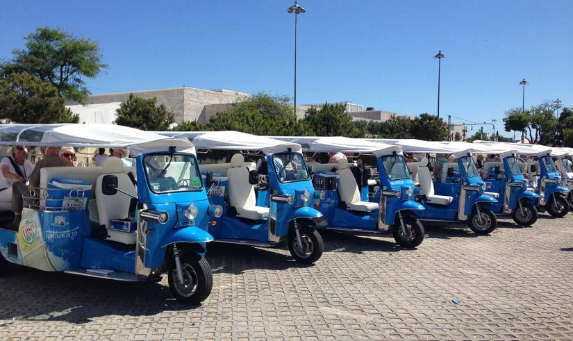 a line of blue tuk-tuk tour in Lisbon