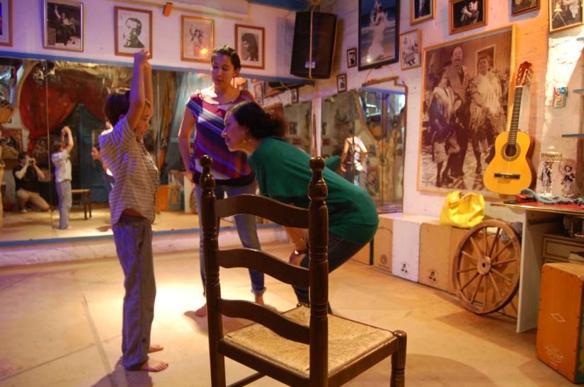 boy learns flamenco with lady teacher in Seville