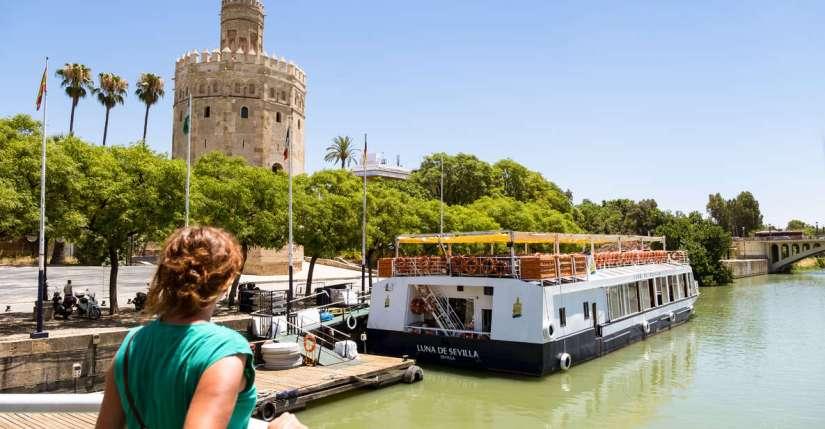 a woman looks toward the Guadalquivir Cruise