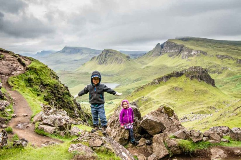2 kids are at the isle of skye in scotland