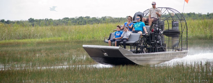 a family on airboat at Everglades National Park