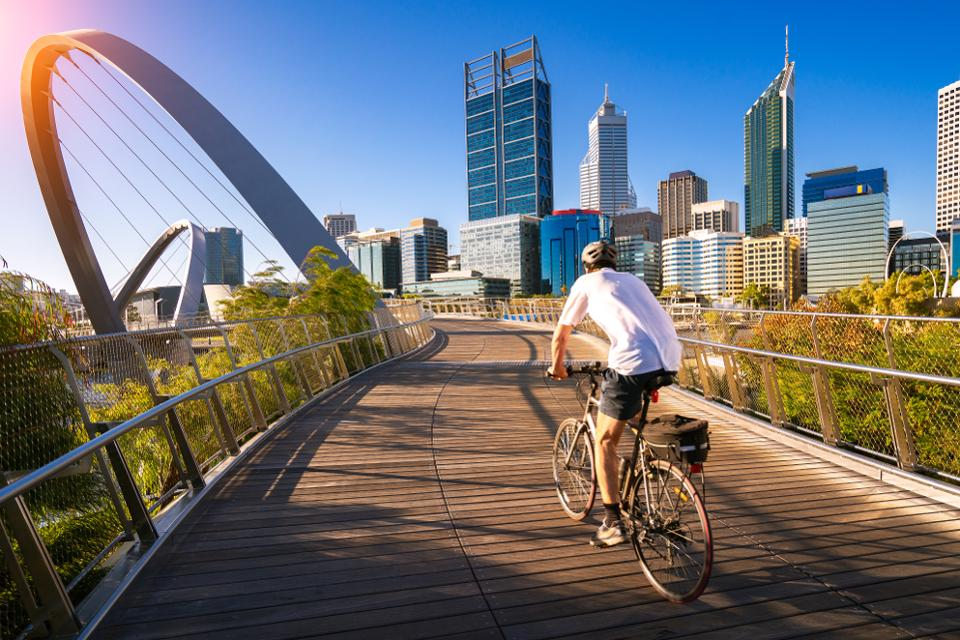 a man cycling on Elizabeth Quay bridge