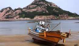 A fishing boat waits for high tide on Seonudo Island in South Korea.
