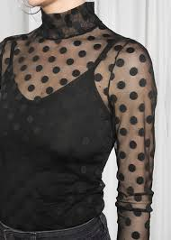 Mona Roma Ferry Review - lady in see through spotty blouse