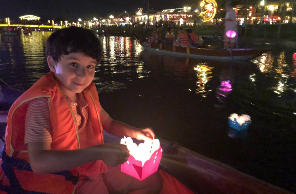 My son at the light festival in Hoi An