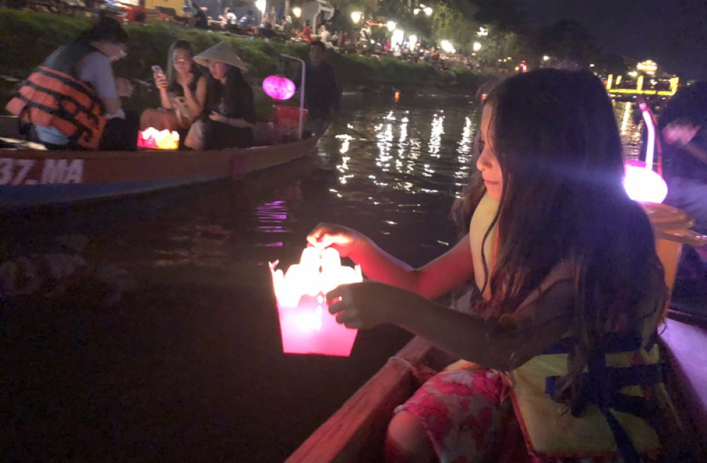 My daughter at the light festival in Hoi An