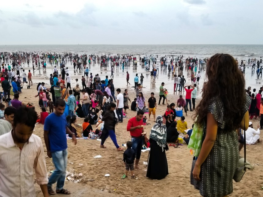how solo travel changes you; solo travel female mumbai india beach crowded litter crow bombau