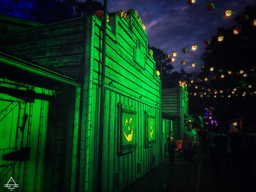 Green building with and pumpkin lights