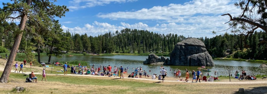Sylvan Lake with a crowd on the beach