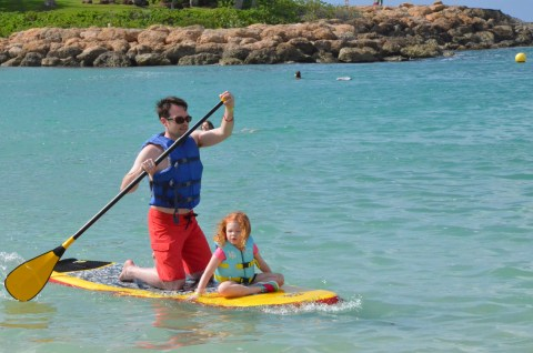 First time on a paddle board with daddy.