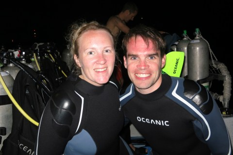 My husband and I on a night scuba dive with manta rays in Hawaii - not cheap, but worth it!