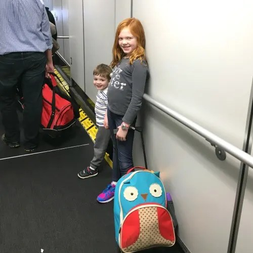 Unexpected Airline Fees - Kids Boarding Plane