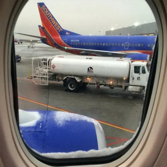 Snowing in RDU Aboard Southwest Airlines