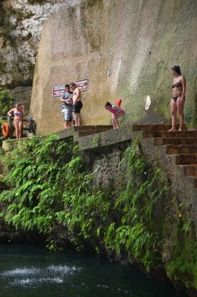 Adventurous kids will enjoy jumping into Cenote Ik Kil after visiting Chichen Itza.