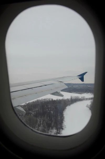 Winter Weather Air Travel Tips - Snow Airplane Wing