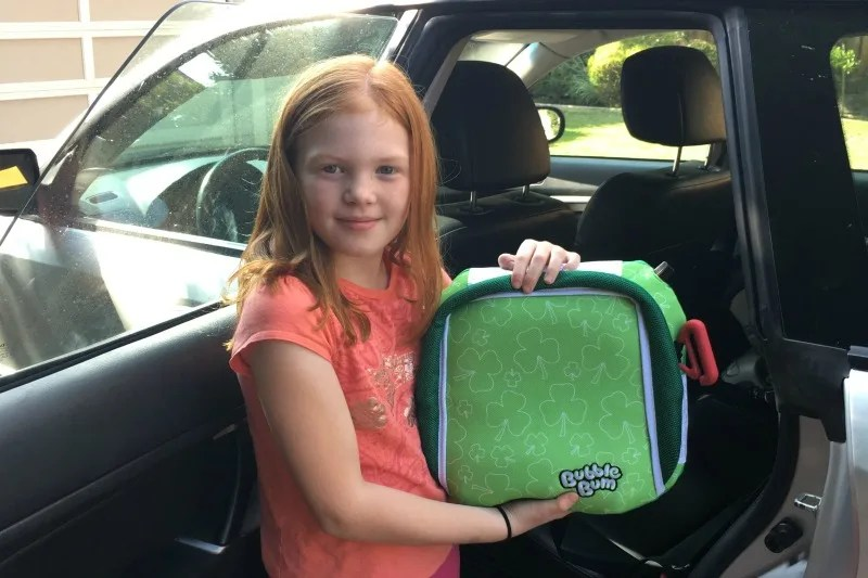 Use a BubbleBum booster instead of a car seat for older children at Disney World