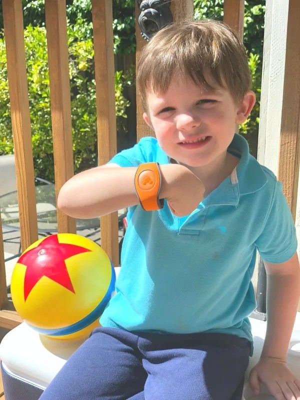 Disney World MagicBands - Child Wearing Orange MagicBand