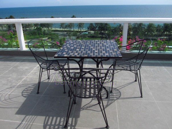Wrought iron and mosaic patio table and chairs