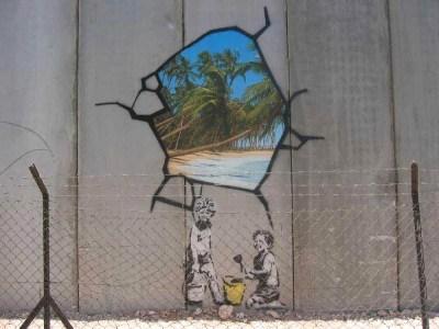 Banskyjev rad na zidu koji dijeli Izrael i Palestinu (Foto: Markus Ortner/Wikipedia)