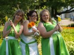 Green grass, green bridesmaid's dresses and a new bride.