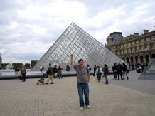 Patrick pretending to be Superman at the Louvre.