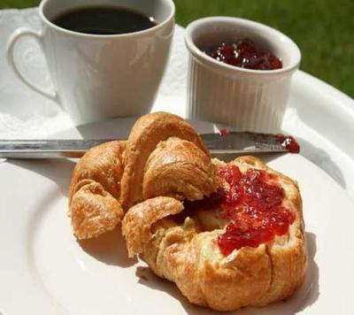 warm croissants with strawberry jam