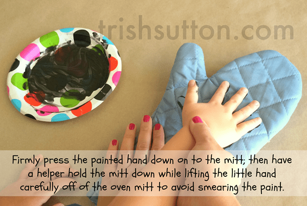 Firmly press the painted hand on oven mitt; TrishSutton.com