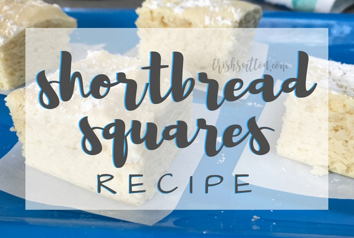 Shortbread Squares Recipe; Simple and Slightly Sweet made with Cream Cheese and topped with Powdered Sugar. TrishSutton.com