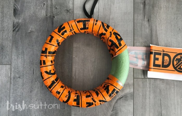 Haunted Halloween Wreath; Simple, spooky and festive Halloween decor made with Caution, Keep Out or Haunted Tape. October Dollar Store DIY by Trish Sutton.