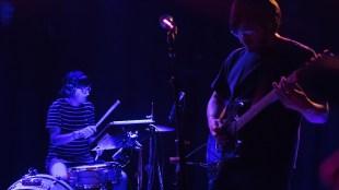Guitarist Jordan Shih rocking alongside new drummer of SALES' 2016 touring season. (Tahiez Toro / The Triton)