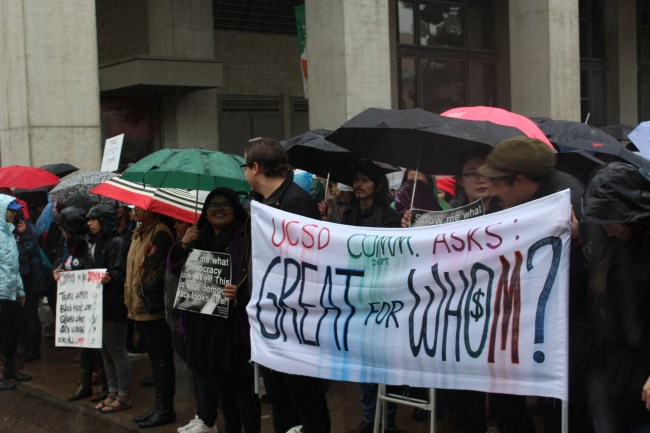 Hundreds gathered to protest and strike despite the rain. (AJ Peterson/The Triton)