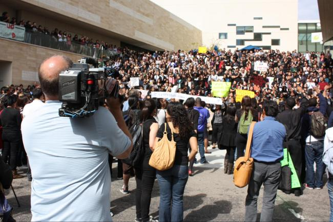 Media covers the student protest near of the Triton Statue steps. Photo courtesy of John Im & MG Abugan. 2010.