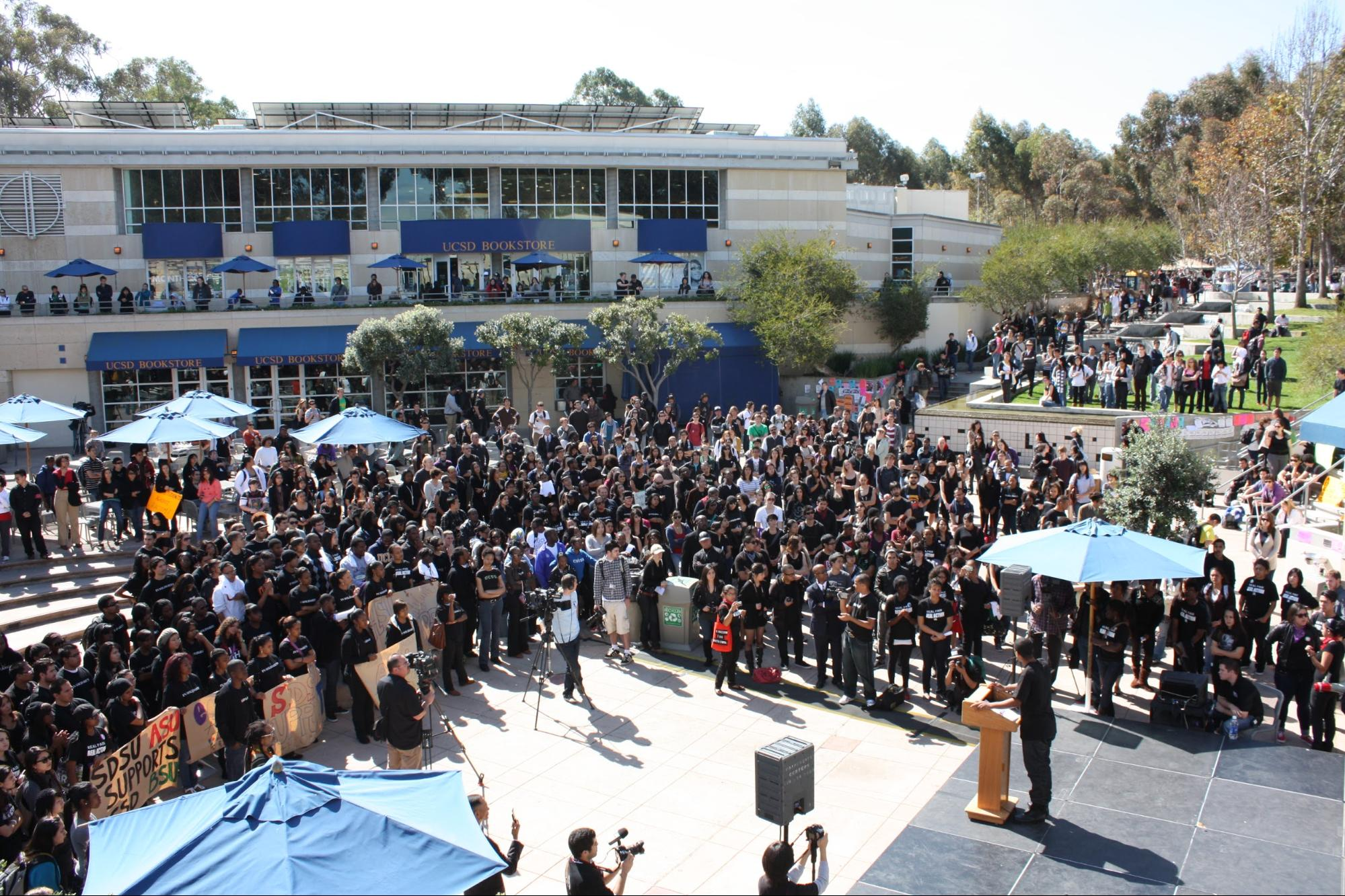 Students crowd Price Center in protest. Photo courtesy of John Im & MG Abugan. 2010.
