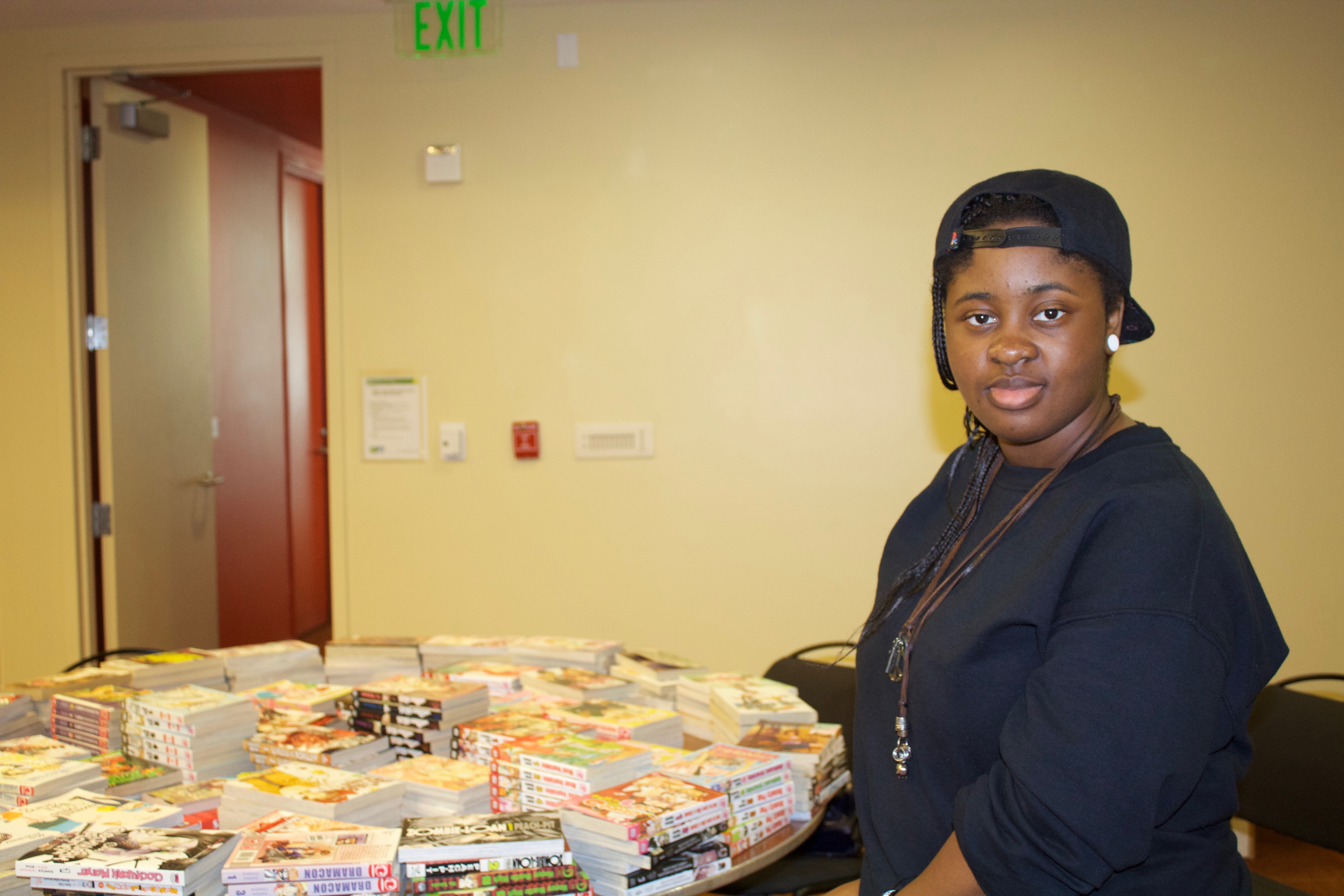 Cal Animage Beta Officer Gladys Balogun watches over the Animefest library. (Gabriela Romero / The Triton)