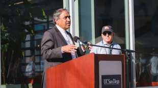 HDH Director Mark Cunningham stands in the background as Chancellor Pradeep Khosla speaks at on. (/)