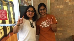 Hemlata Jhaveri (left) with a student at UT Austin. Photo from Hemlata Jhaveri's Twitter profile.