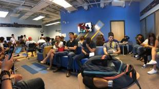 Students sit at the Financial Aid and Scholarships Office. Image courtesy of Ashley Warner via Facebook.