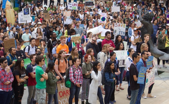 Photo of students demonstrating at the September 27 climate strike in front of the Triton Statue in Price Center at UCSD.