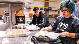 Members of the Food Recovery Network recovering food at Revelle dining facility.