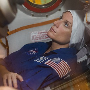 """Rubins conducts a """"fit check"""" aboard the Soyuz MS-01 spacecraft in Kazakhstan's Baikonur Cosmodrome prior to launch for a four-month mission aboard the ISS."""