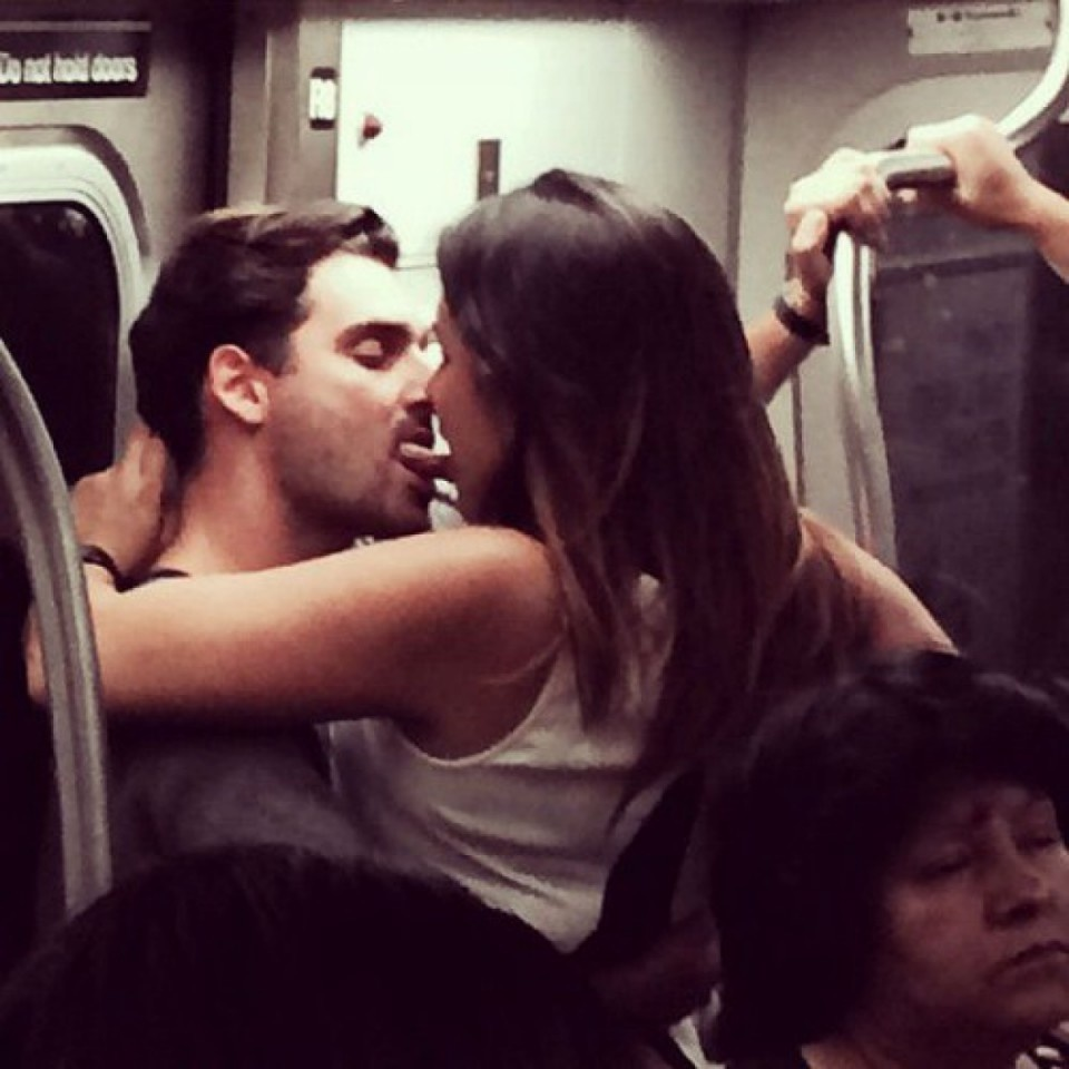 Couple making out on subway