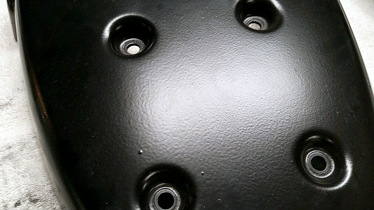 How to spray clear coat without orange peel - Close Up View Of Untouched Rear Seat Panel Orange Peel In Painted Finish