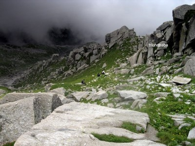 Pause on Trail to Indrahar Pass amidst Fog and Rain
